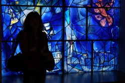 Virginia silhouetted against Chagall's American Windows