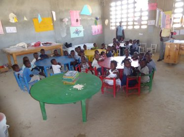 We visited this classroom with one table each of 2-, 3-, 4-, and 5-year-olds, at impossibly low tables. joy!
