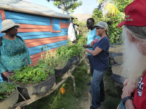 The young man in the background is Maccenje, an Animator who had a wife and two daughters and had done an excellent job of adopting MPP methods of farming. This is his property, including dozens of raised tire gardens. In the foreground, our translator, Juliette.
