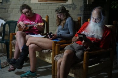 At nights, we relaxed, J-Mac plays the ukelele, Julia checks photos from the day, and mike reads on his Kindle.