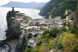 Vernazza snakes its way to the water along a stony backbone