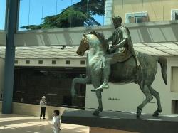 Marcus Aurelius equestrian statue at Capitoline Museum. People in photo for scale.