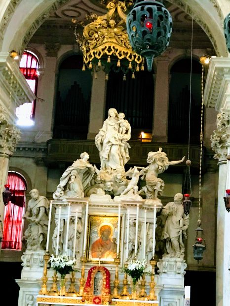 In Salutan cathedral, this altar tells the story of Venetians imploring baby Jesus and the Spirit of Venice (not Mary) to lift the plague, and a cherub then chasing away Old Lady Plague. Agist Beauty.